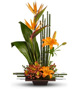 Striking high style fresh flower arrangement in warm autumn colors.